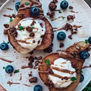 Spiced Pear Toast | This cozy fall recipe isn't actually toast, but it's a delicious healthy breakfast that's Paleo, gluten-free and refined sugar-free. Think yummy baked spiced pears topped with creamy yogurt and other healthy toppins. It's an idea healthy breakfast for fall, and it also works as a healthy snack or healthy dessert option! | Shuangy's Kitchen Sink #shuangyskitchensink #Paleo #refinedsugarfree #glutenfree #healthybreakfasts #healthysnacks #healthydesserts #pears
