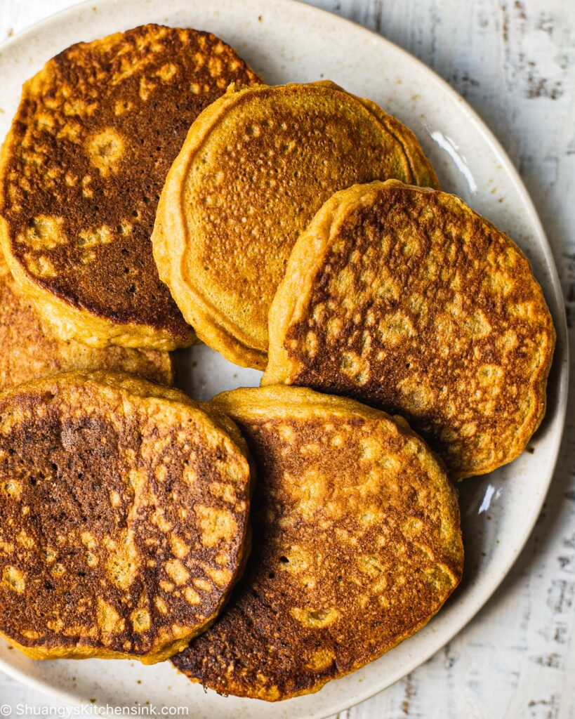 A plate full of fluffy gluten-free pancakes