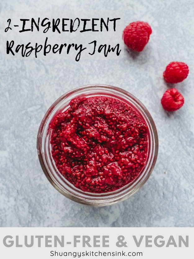 A jar of raspberry chia jam made with raspberries and chia seeds. There are a few raspberries on the side.