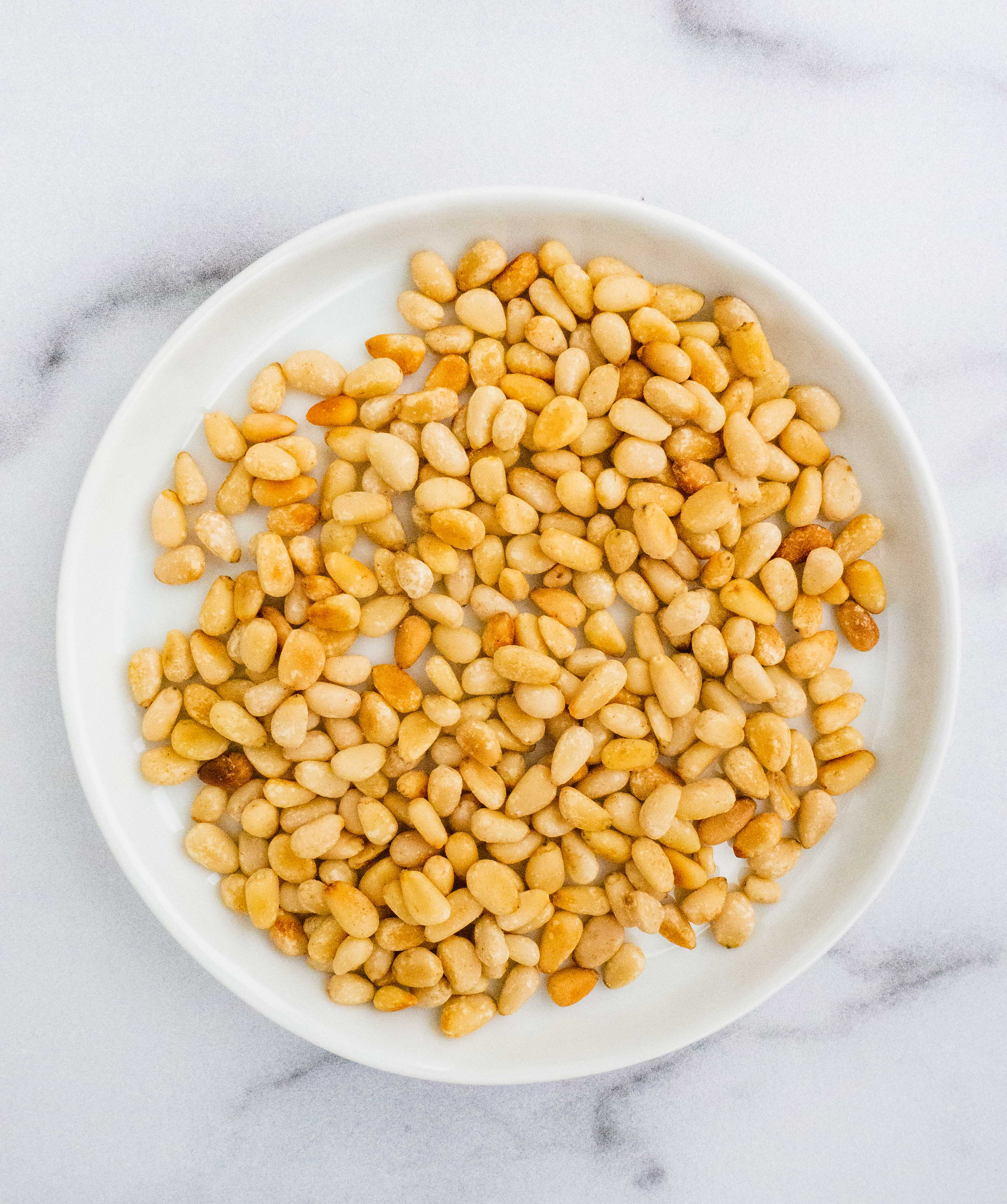 Main ingredient for vegan basil pesto: toasted pine nuts