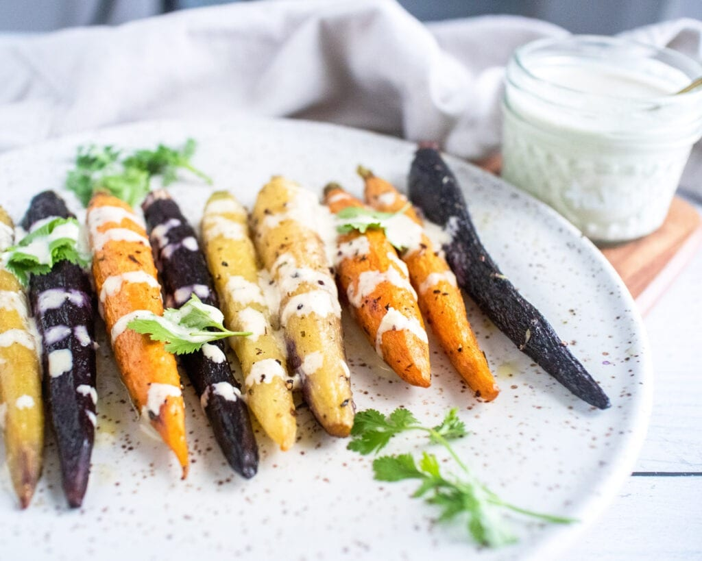 rainbow carrots drizzled with gluten free lemon tahini dressing