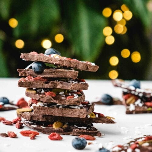 Superfood Chocolate Bark | This healthy dessert recipe has all your bases covered -- chocolate, superfoods, raw, Paleo, vegan, and it tastes amazing! This is a dessert you can really feel good about eating. | Shuangy's Kitchen Sink #ShuangysKitchenSink #paleo #raw #vegan #rawdessert #vegandessert #chocolate #chocolatedesserts #superfoods #superfoodsrecipes