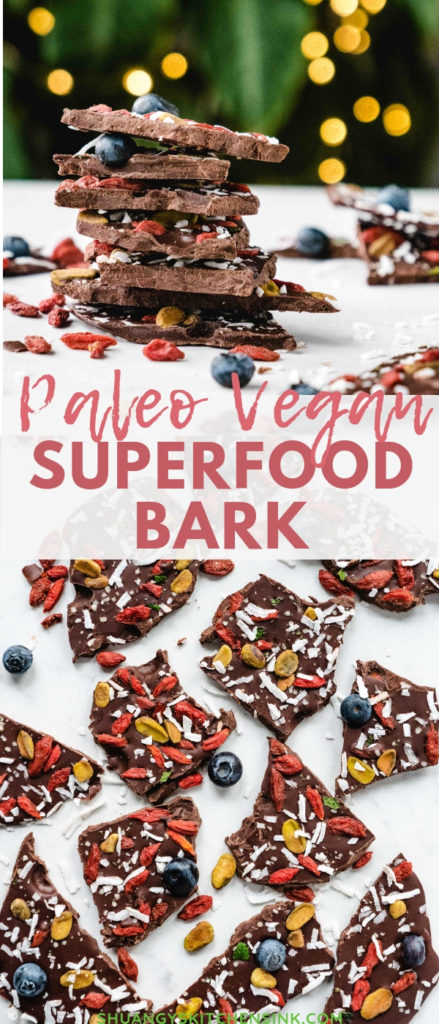 Raw pieces of Peppermint bark stacked on top of each other. The chocolate is covered with superfoods and other paleo toppings.