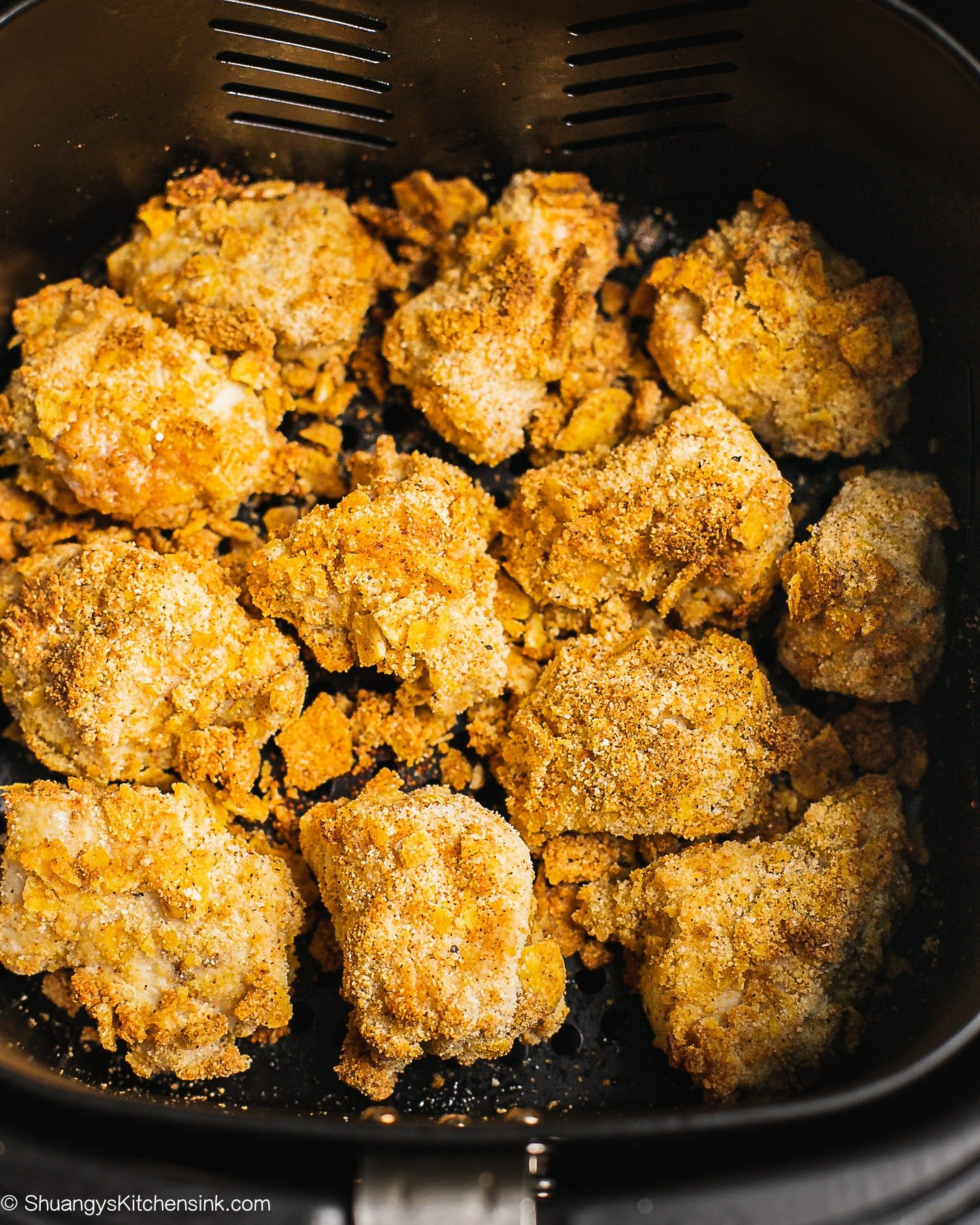 A basket of air fryer chicken nuggets that look crispy and golden brown on the outside.