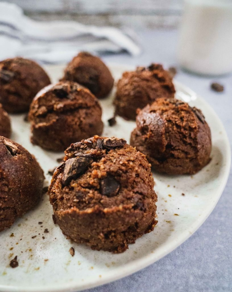 there are chocolaty and gooey raw energy bites in a plate