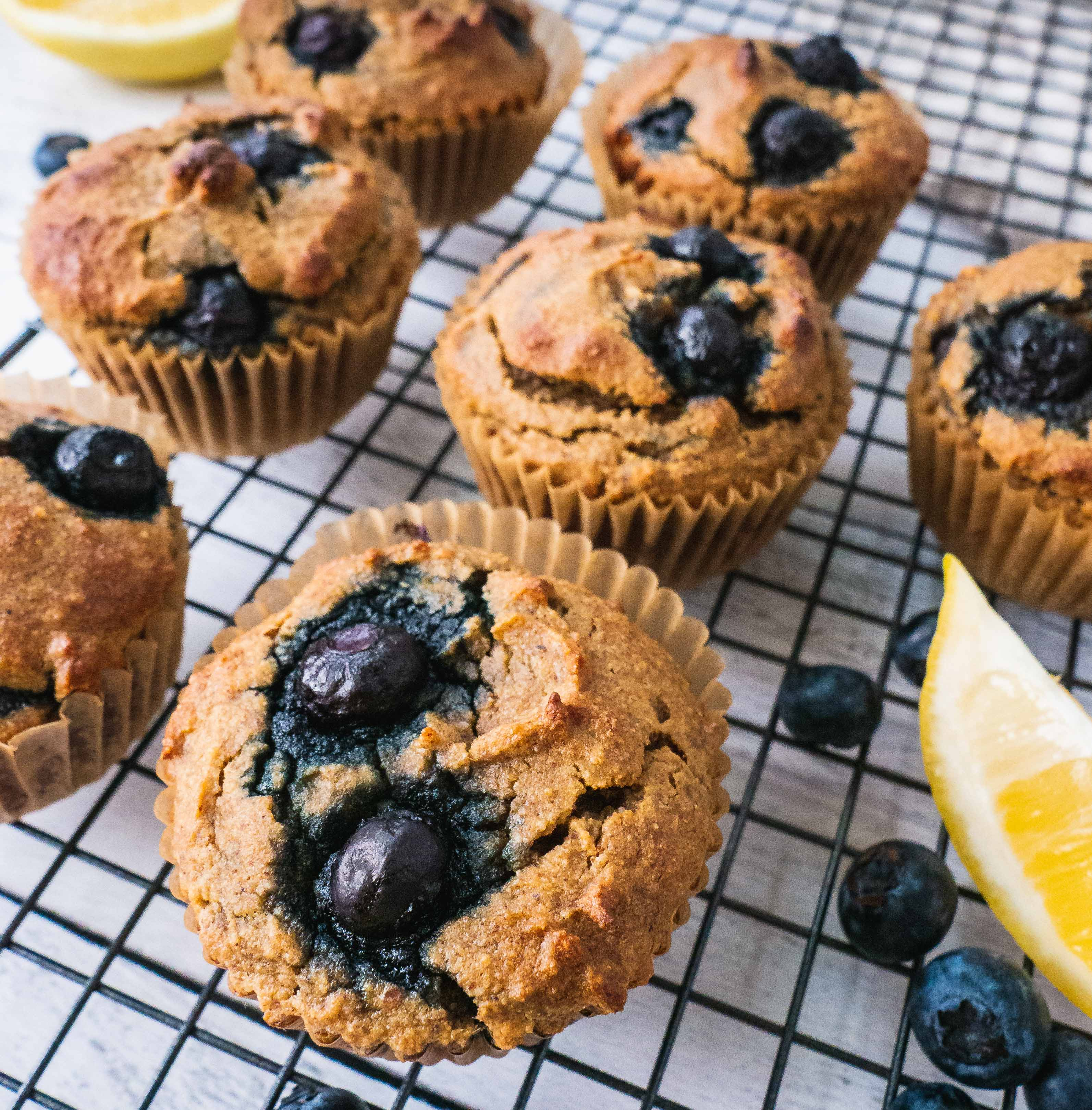 These Healthy Blueberry Lemon Muffins are the best breakfast option to make ahead, grab on the go for a busy morning. This easy muffin recipe is not only paleo, gluten free, but also has the most fluffy, soft and moist texture. Healthy blueberry lemon muffins for a family to enjoy, even your little picky kids eaters. | #Shuangyskitchensink #blueberrymuffin #muffinrecipe #paleo #healthybreakfast #breakfastmuffins #blueberrylemon #glutenfree #glutenfreerecipe