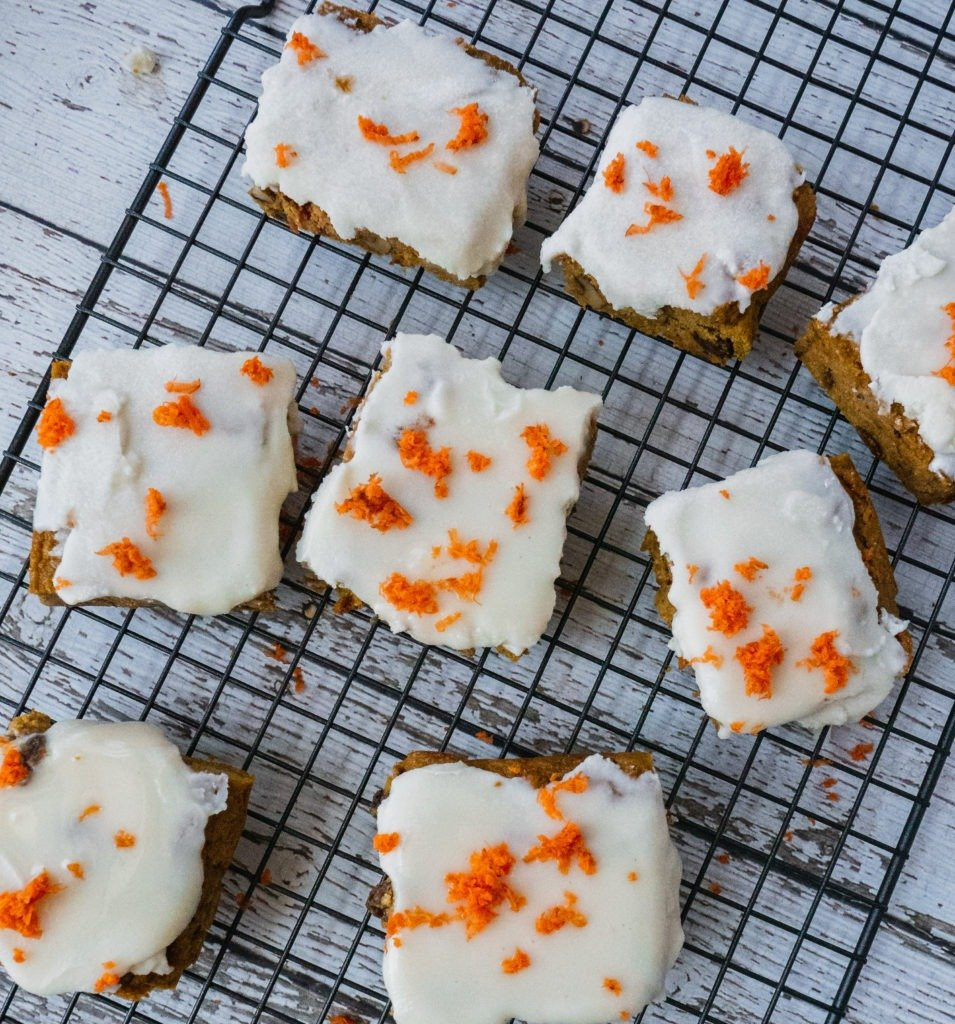 These paleo carrot cake bars are perfect for Easter brunch or just any time of the year. This carrot cake recipe is gluten free, dairy free and paleo. This moist and gooey carrot cake is made with sweet potato, almond flour and coconut flour. healthy on-the-go breakfast or a satisfying dessert or snack. | #shuangyskitchensink #carrotcake #easter #easterbrunch #paleodessert #glutenfreedessert #paleorecipe #glutenfreerecipe #dessertrecipe #healthydessert #desserts #almondflour #coconutflour