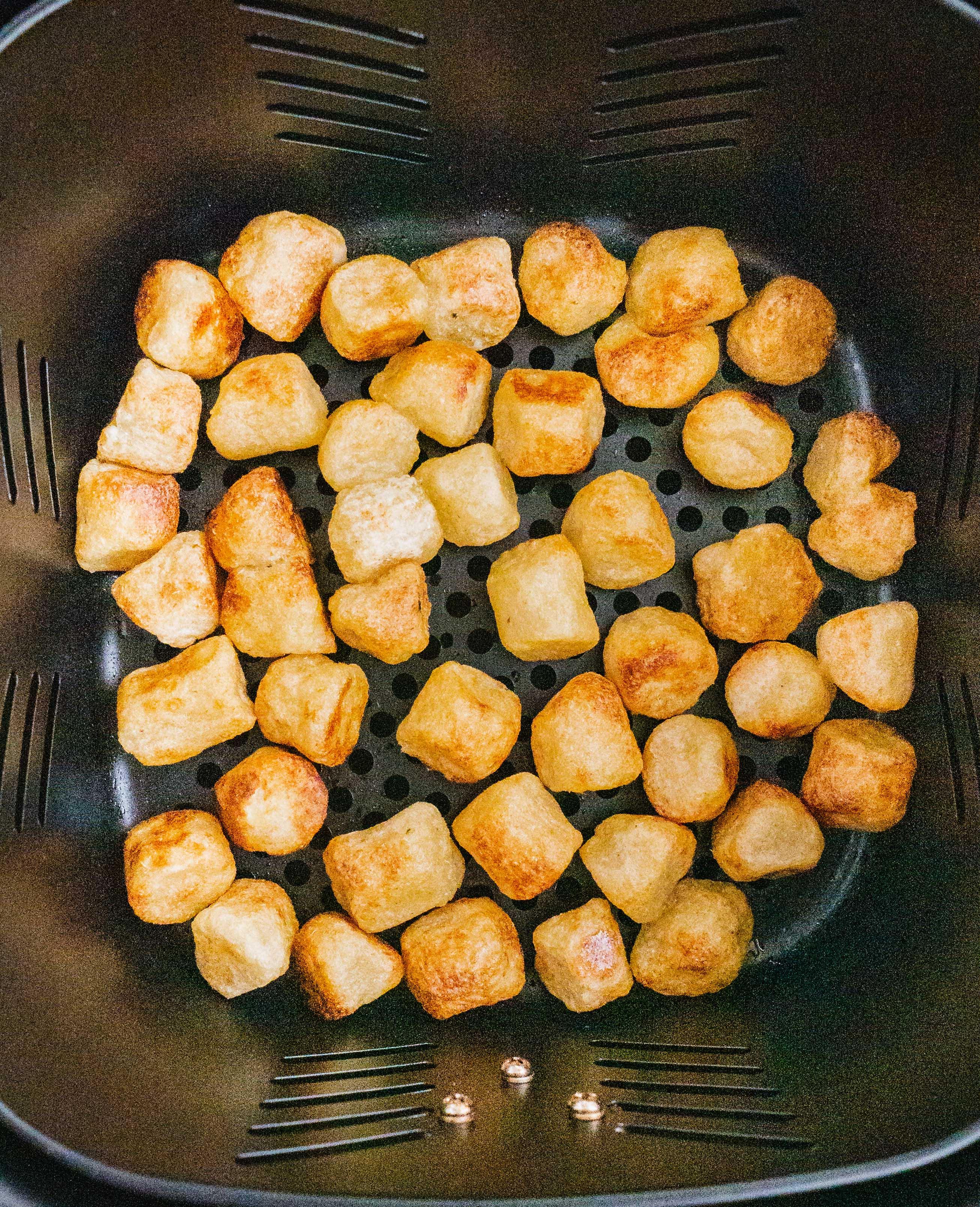 Crispy air fryer cauliflower gnocchi fresh out of the air fryer.