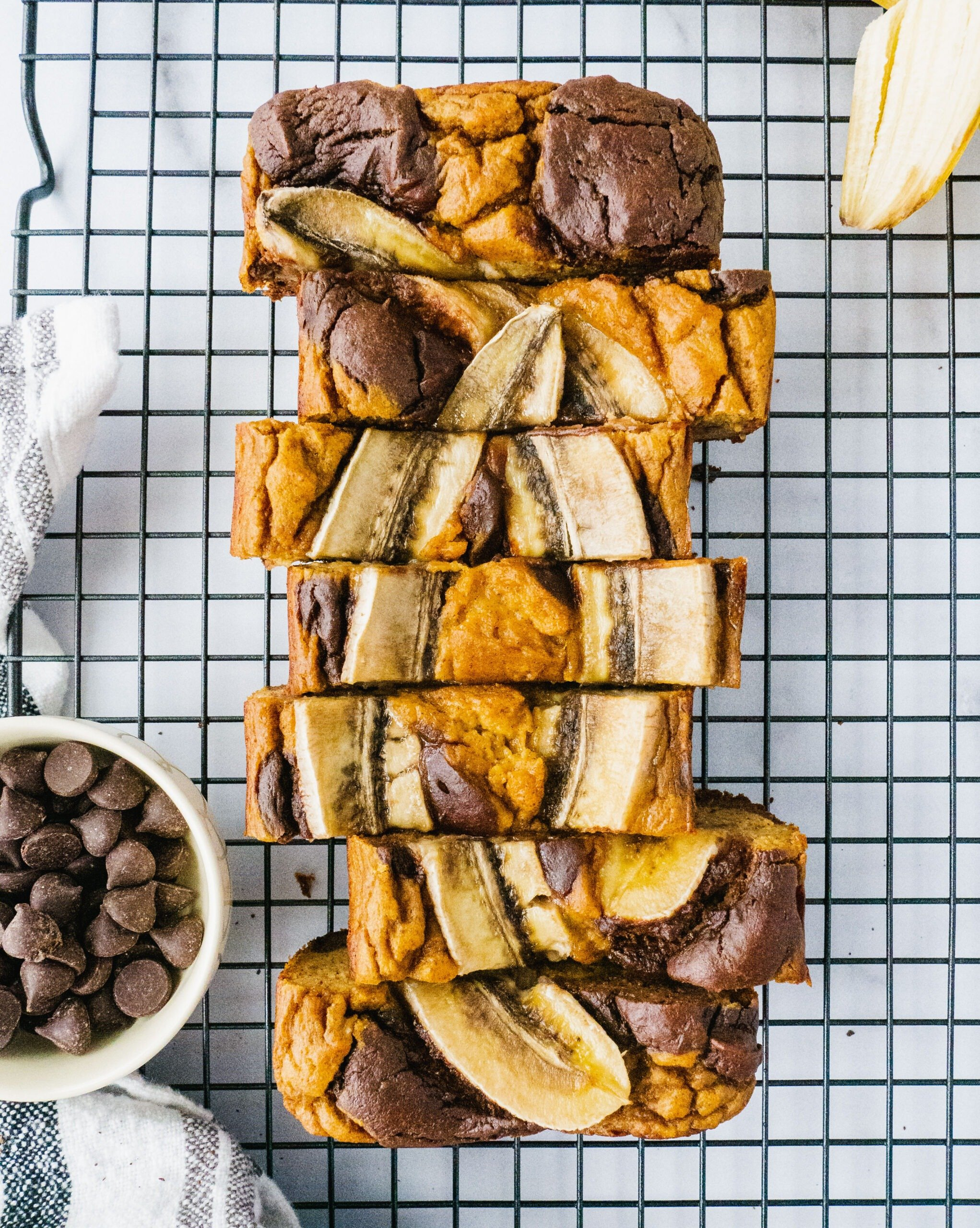 Paleo and gluten free brownie banana bread on a cooling rack with chocolate chip and baanana