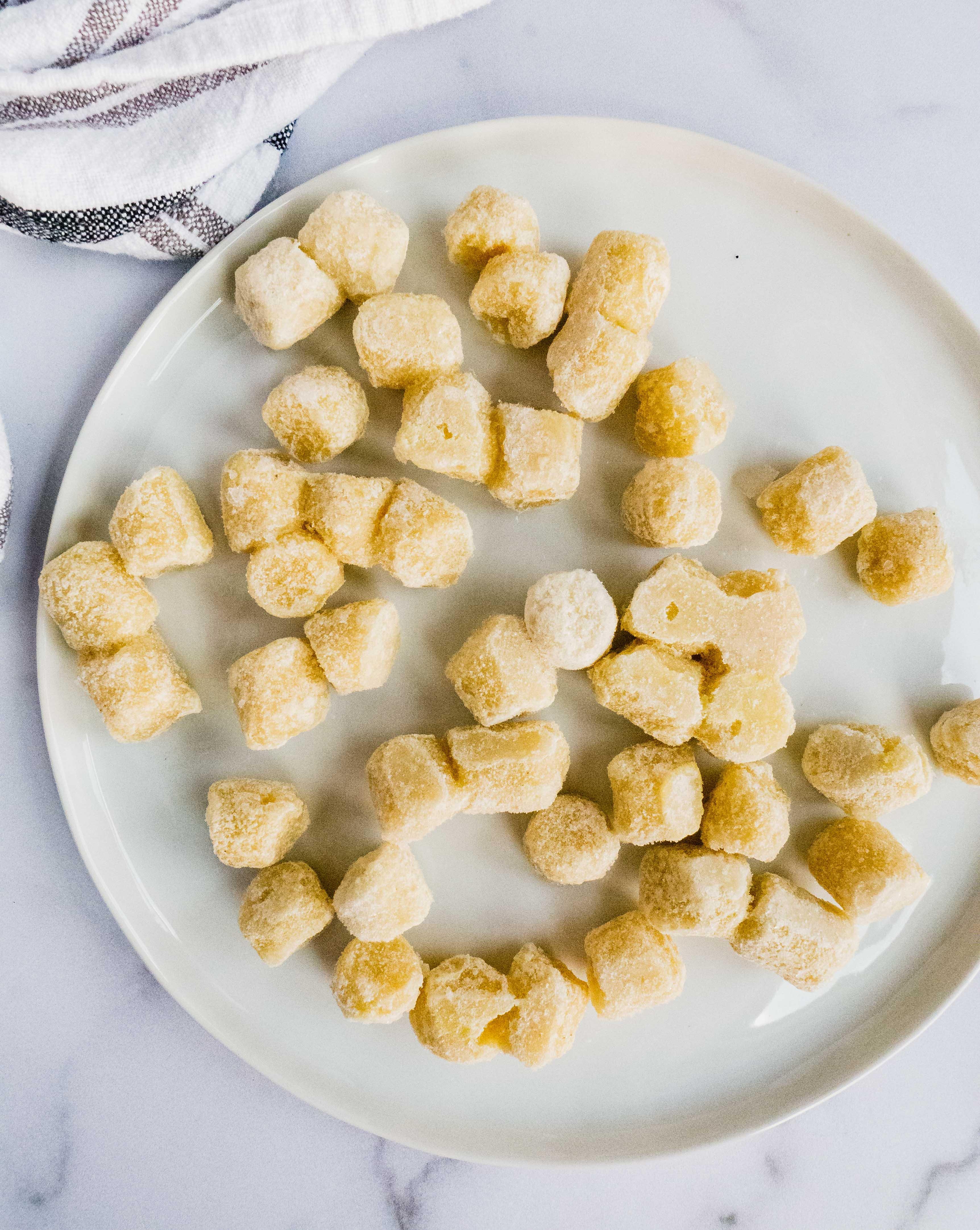Trader Joe's Cauliflower gnocchi frozen on a plate.