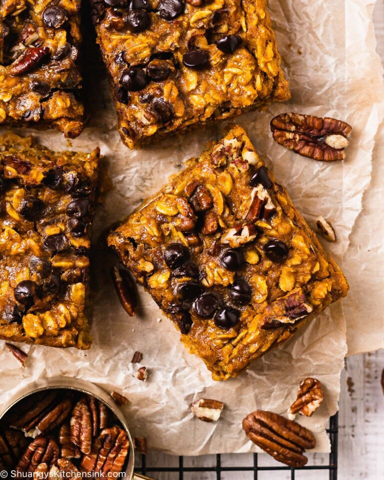 baked breakfast bars topped with dark dairy-free chocolate and pecan nuts