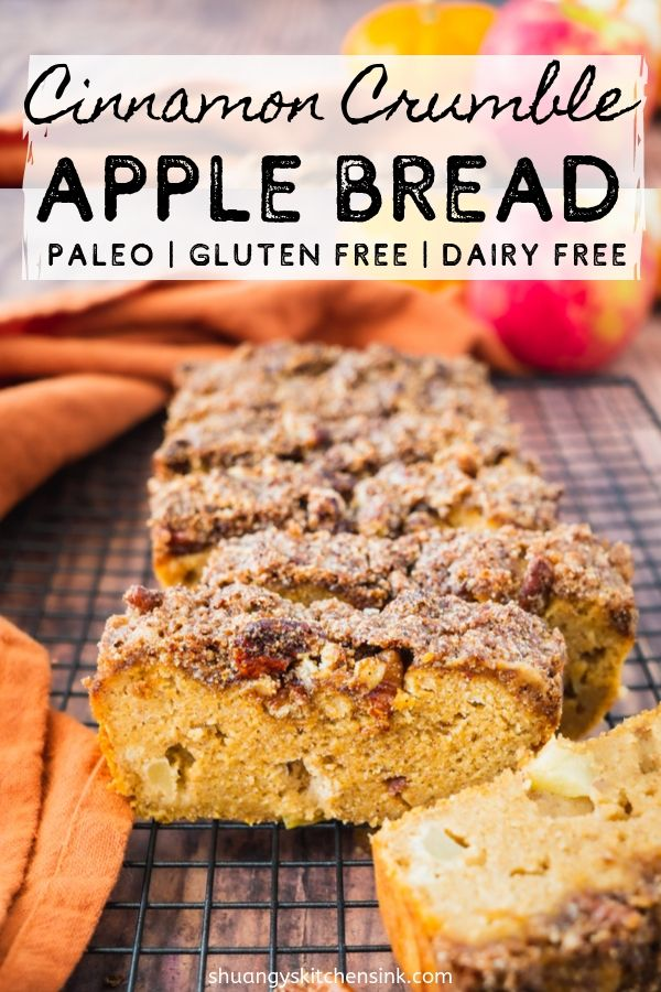 A loaf of healthy crumble bread with crumble toppings on a drying wrack. With an apple and pumpkin the background. pinterest image