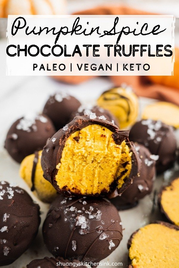 A bite is taken from a gooey and fudgy vegan energy ball