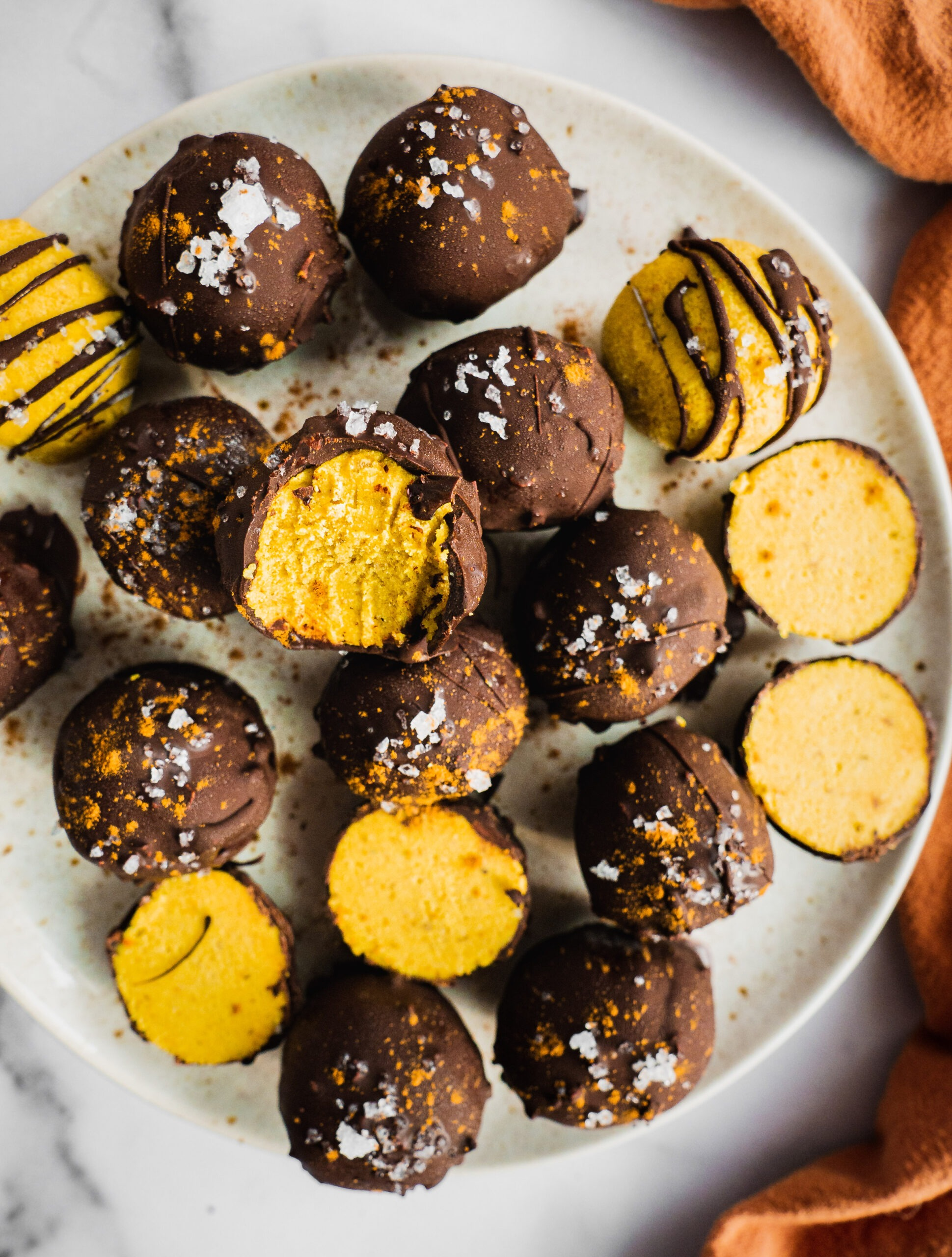 a plate with colorful energy balls made gluten-free, keto, paleo and vegan