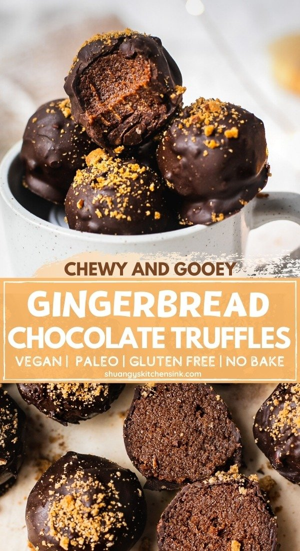 A cozy mug full of gingerbread truffles covered with dark chocolate and topped with gingersnap crumbles. There is a bite on the vegan chocolate truffle and the texture appear to be gooey and smooth. There is Christmas lights in the background.