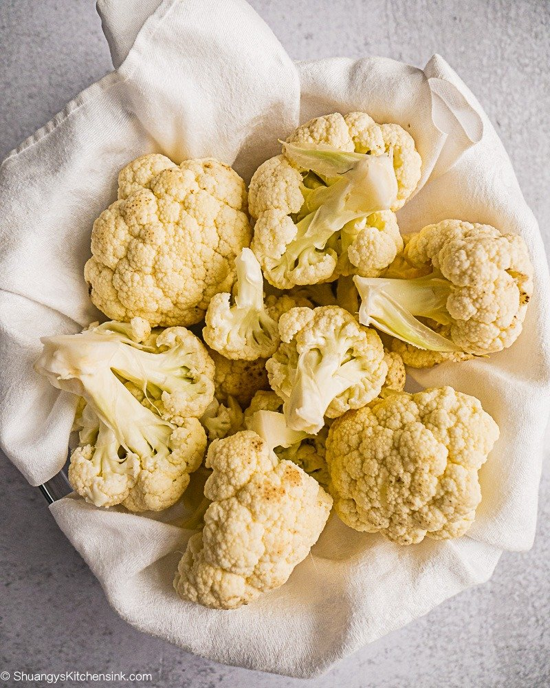 A bowl of washed cauliflower drying