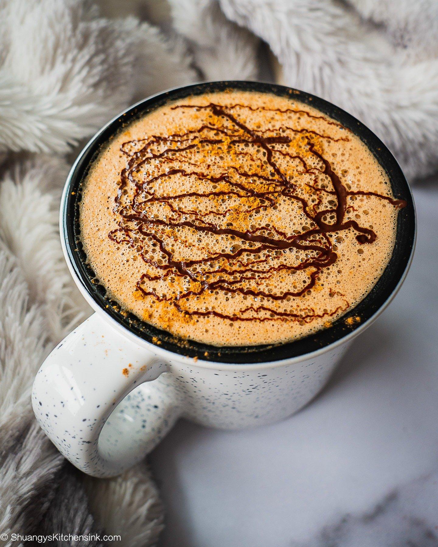 A frothy homemade mocha latte
