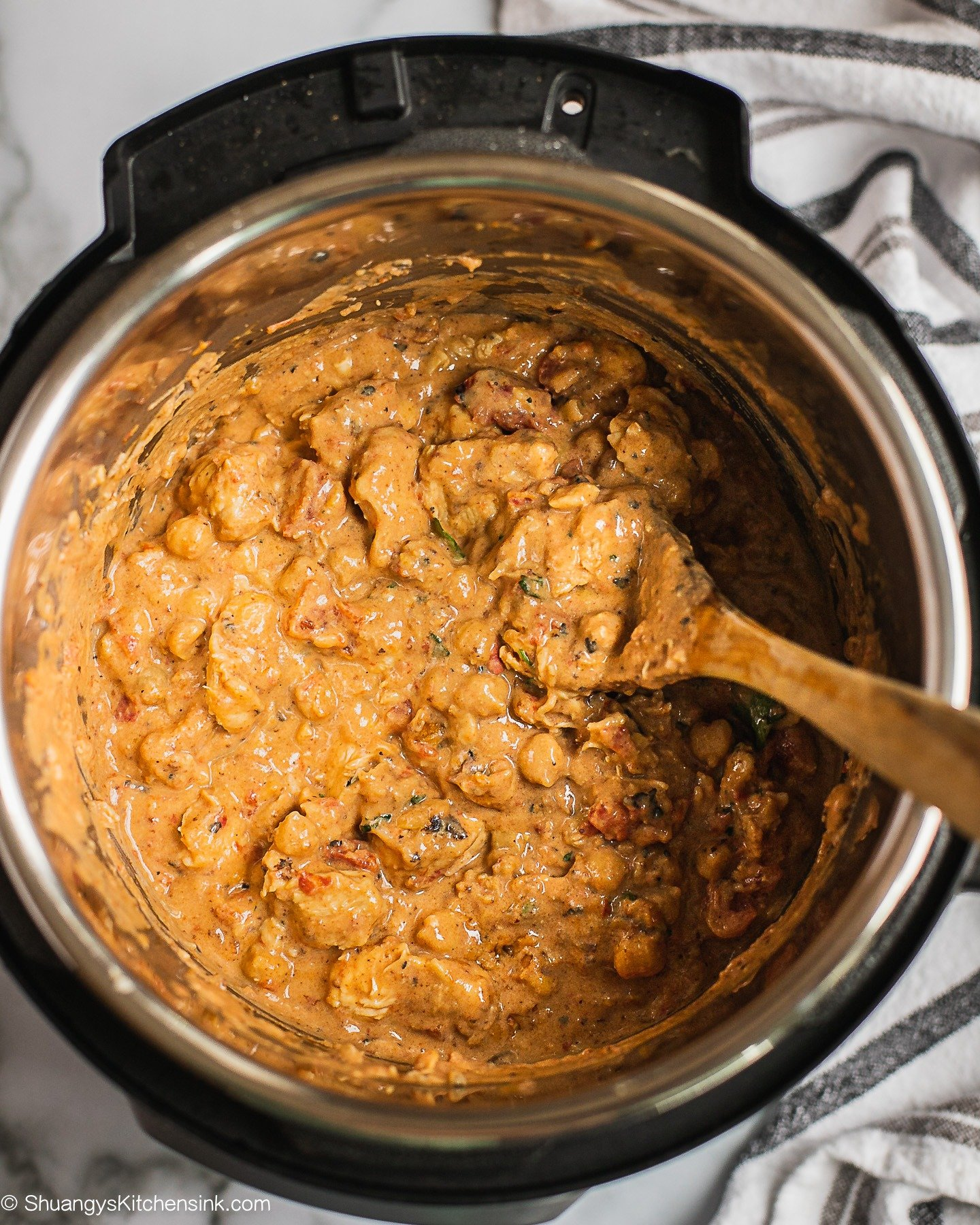 A pot of creamy peanut butter chicken after cooking in pressure cooker.