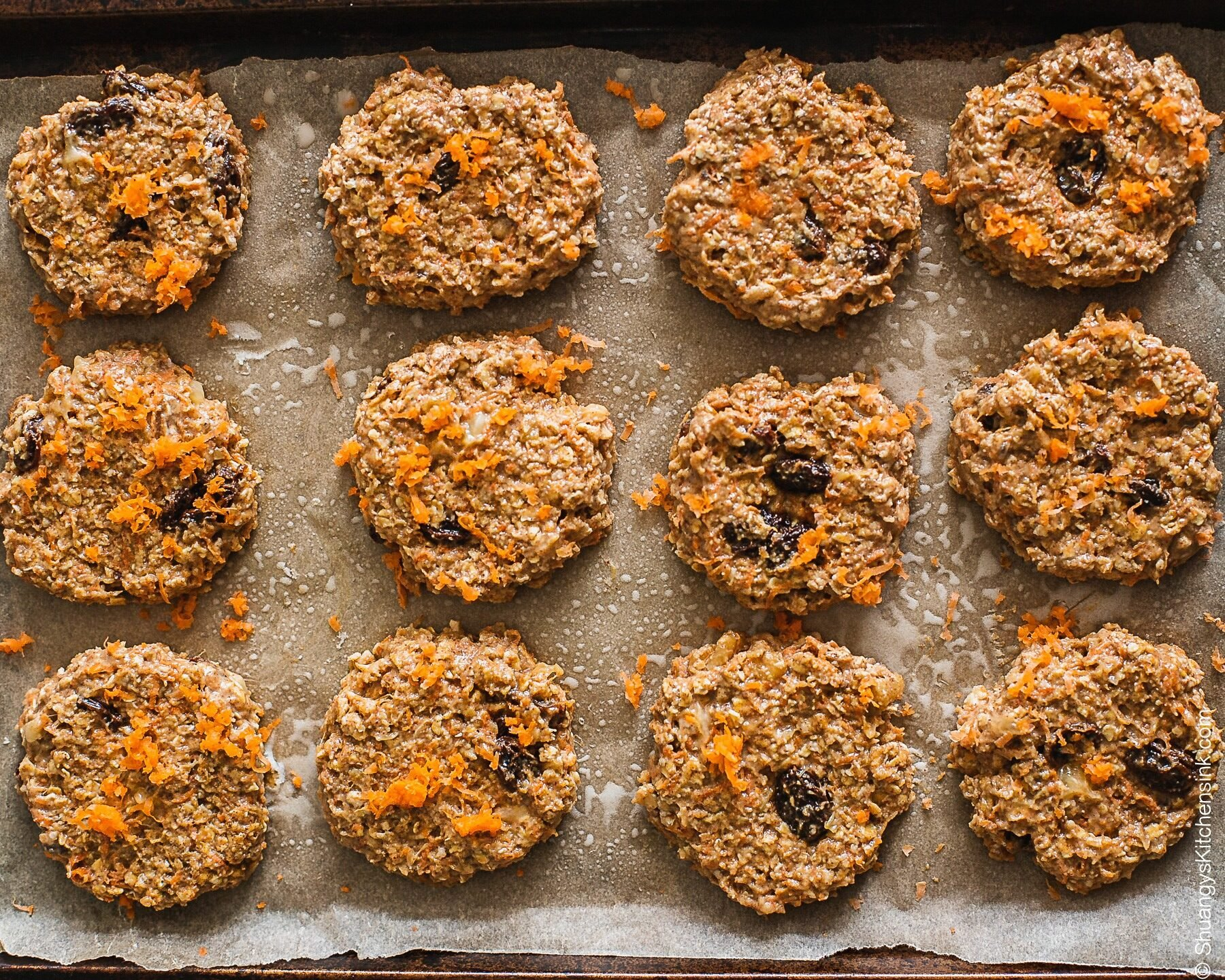 Carrot Cake Oatmeal Cookies about to go into the oven on a cookie sheet.