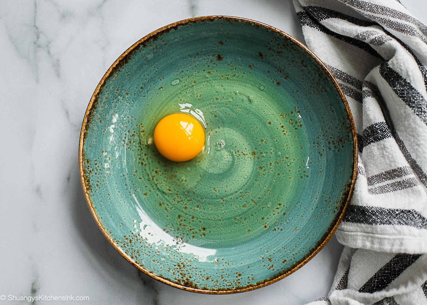 A bowl of egg and olive oil