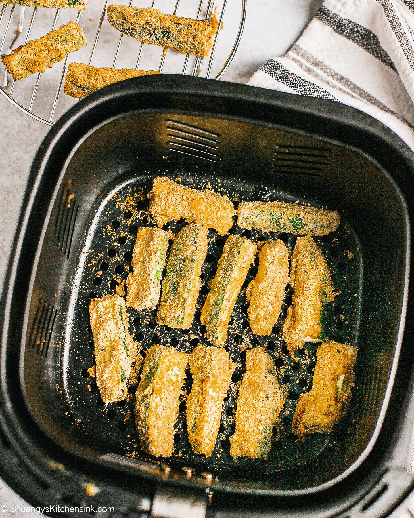 Veggies are being fried in an air fryer for a healthy alternative to french fries