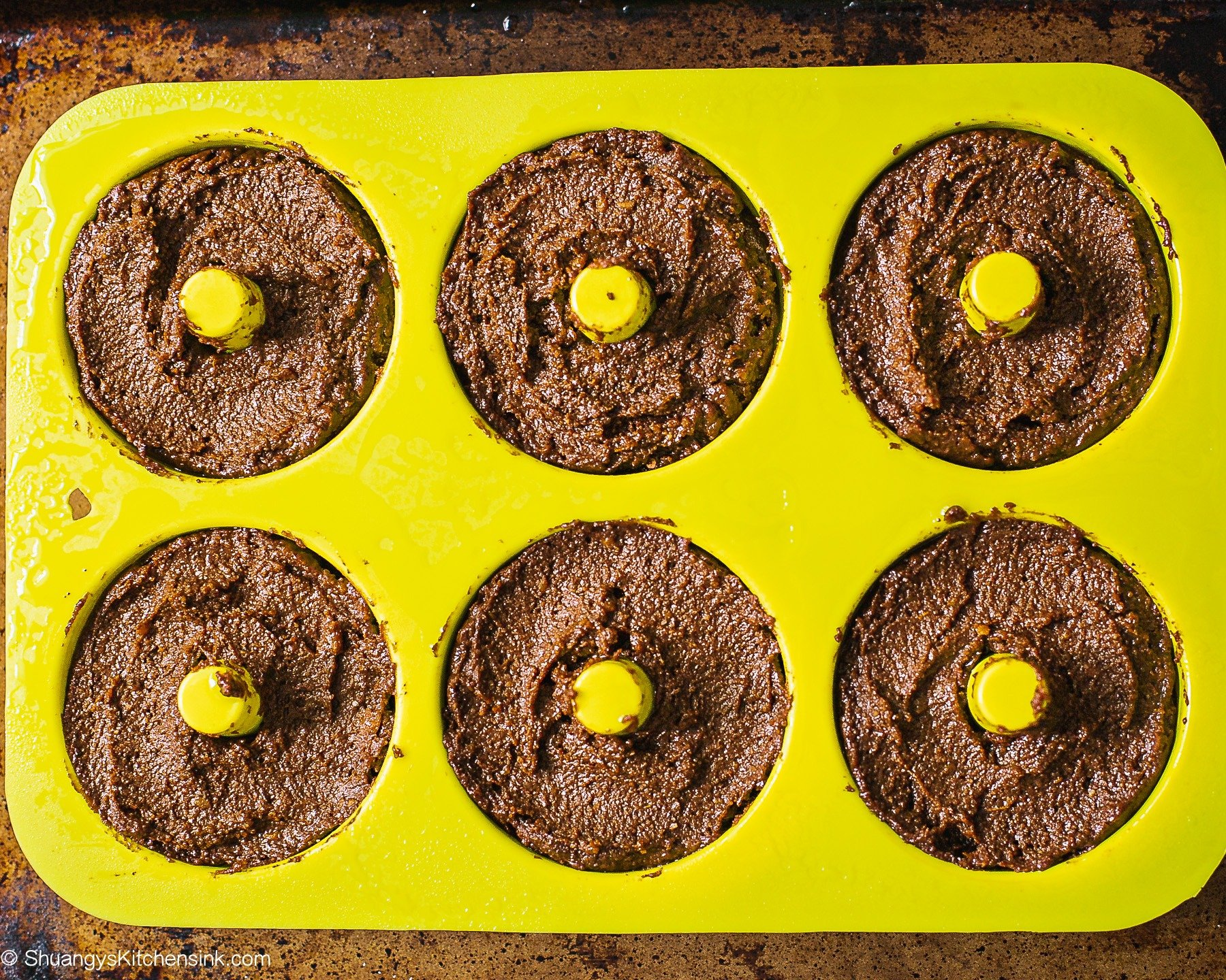 Chocolate donut batter filled silicone donut pan.