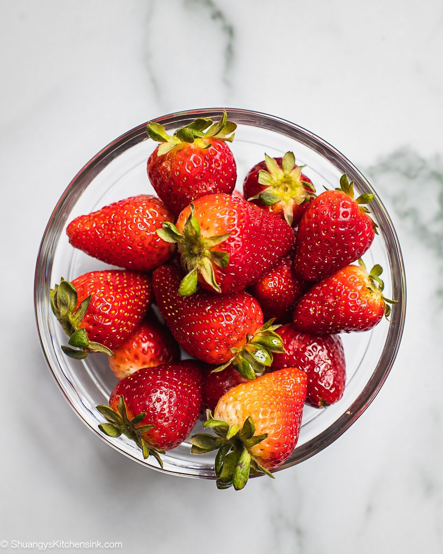 A bowl of fresh and vibrant strawberries.