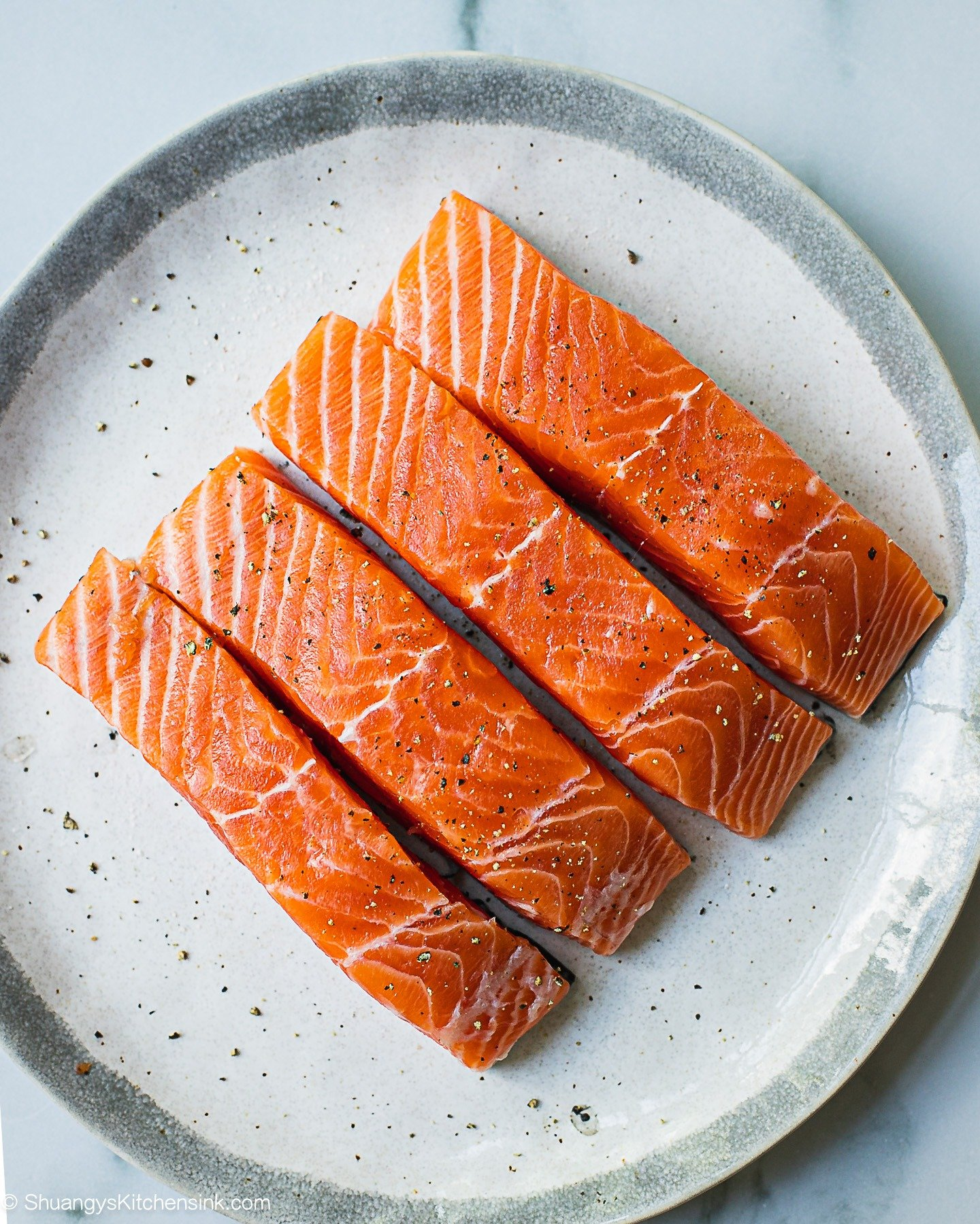 A plate of salmon seasoned recipe to be marinated.