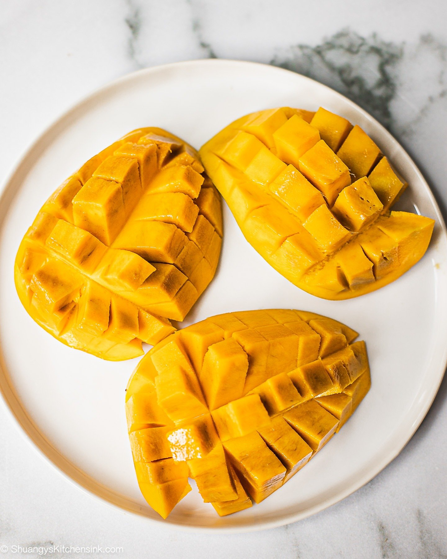 A plate of mango skinned and diced.