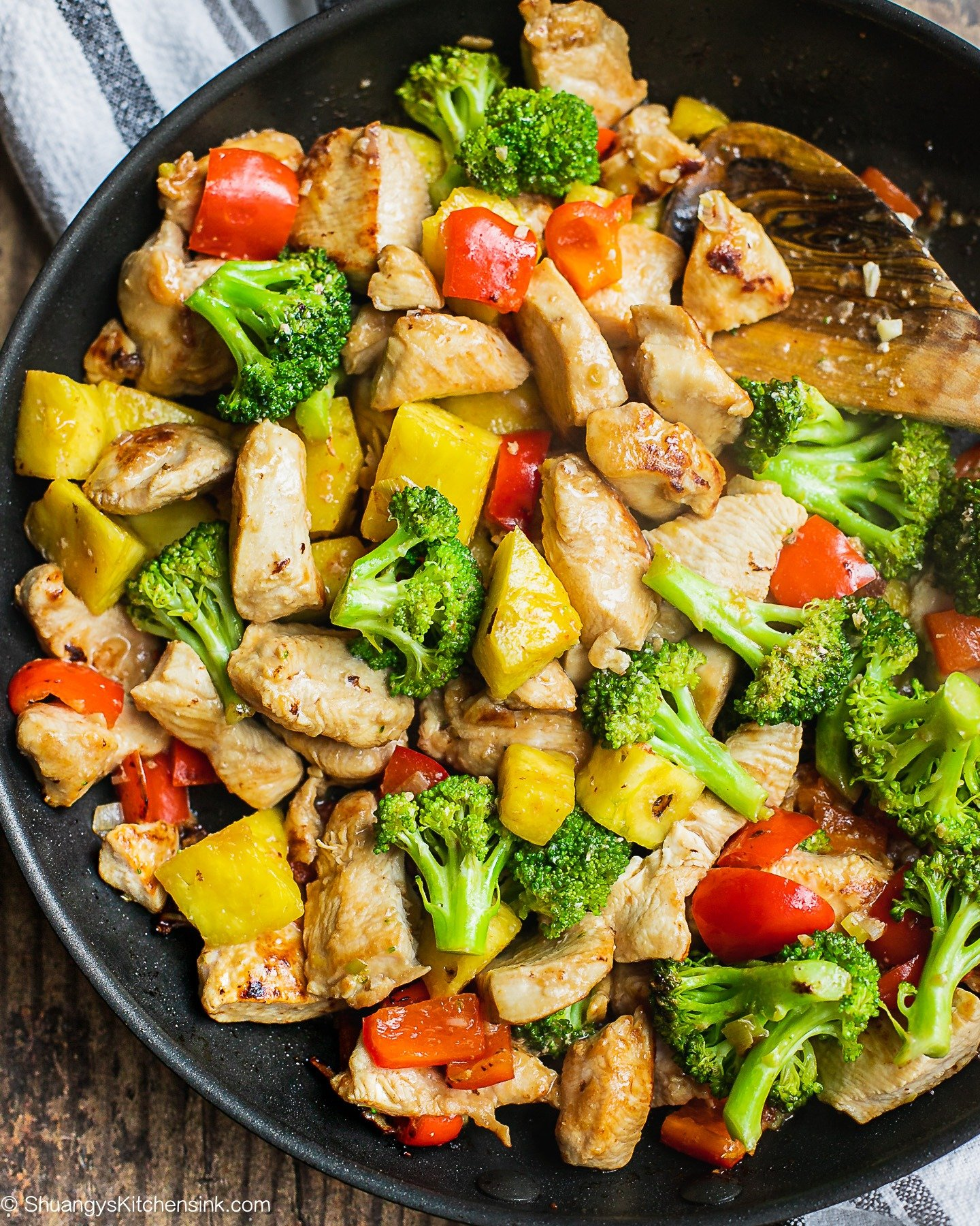 A pan full of pineapple, broccoli and chicken