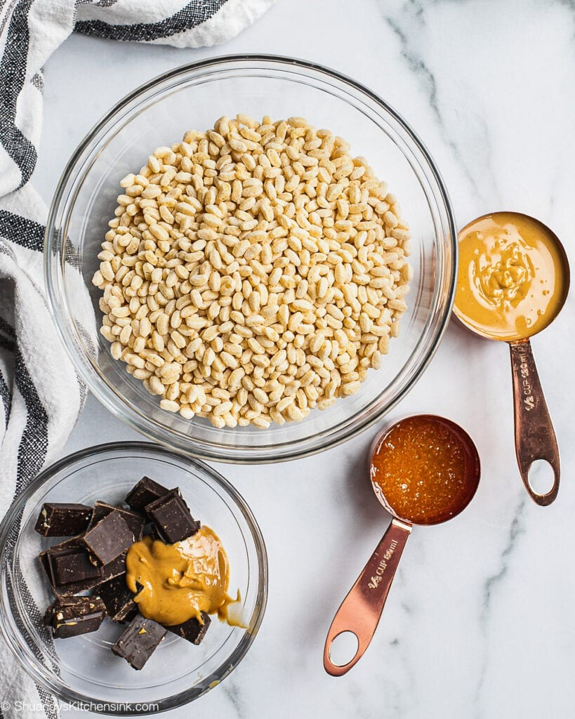 Ingredients needed to make healthy peanut butter chocolate rice crispy treats.