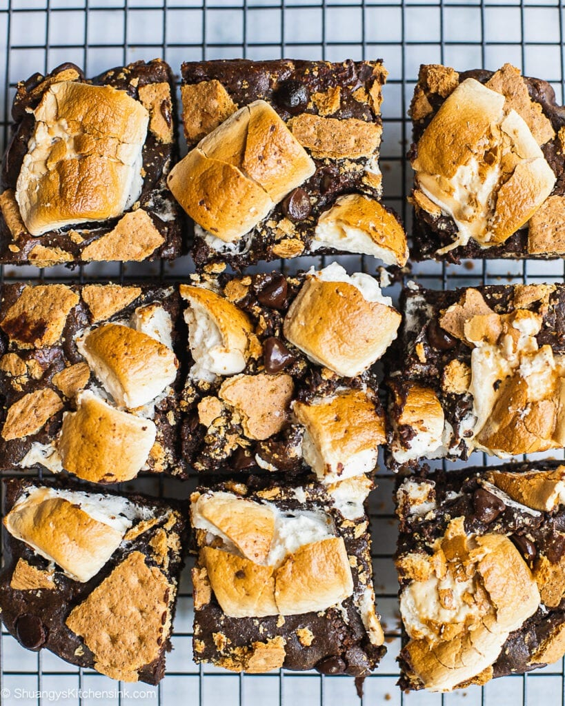 Freshly baked S'mores Brownie with graham cracker crust on the bottom, caramelized marshmallow and graham cracker on top, that looks golden brown.