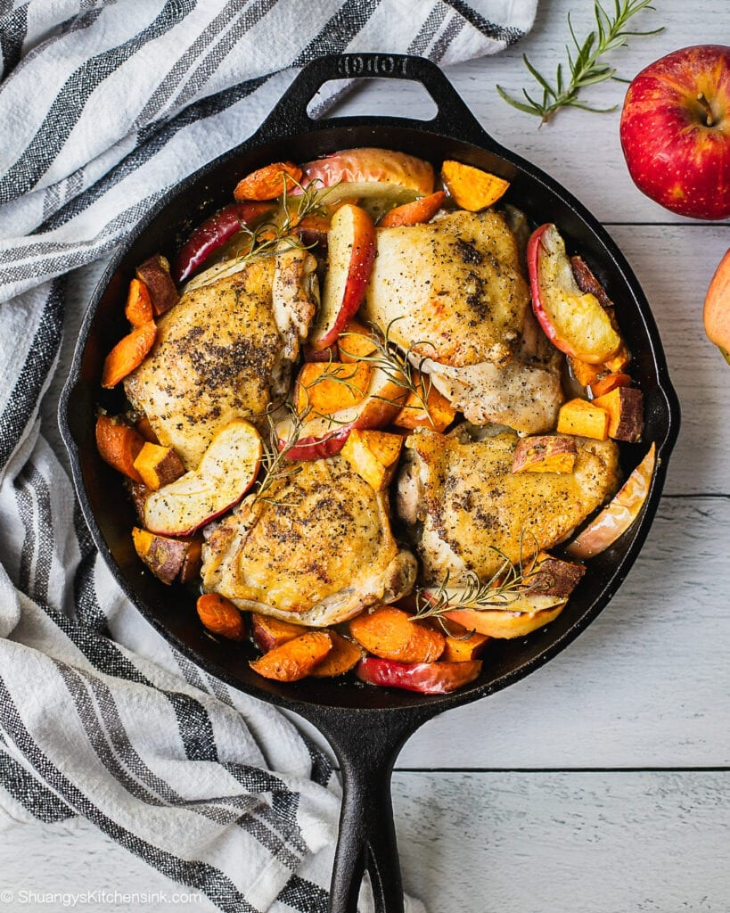 One pan Chicken thighs seared to crispy brown. Topped with cooked apples, carrots, sweet potatoes and fall vegetables.