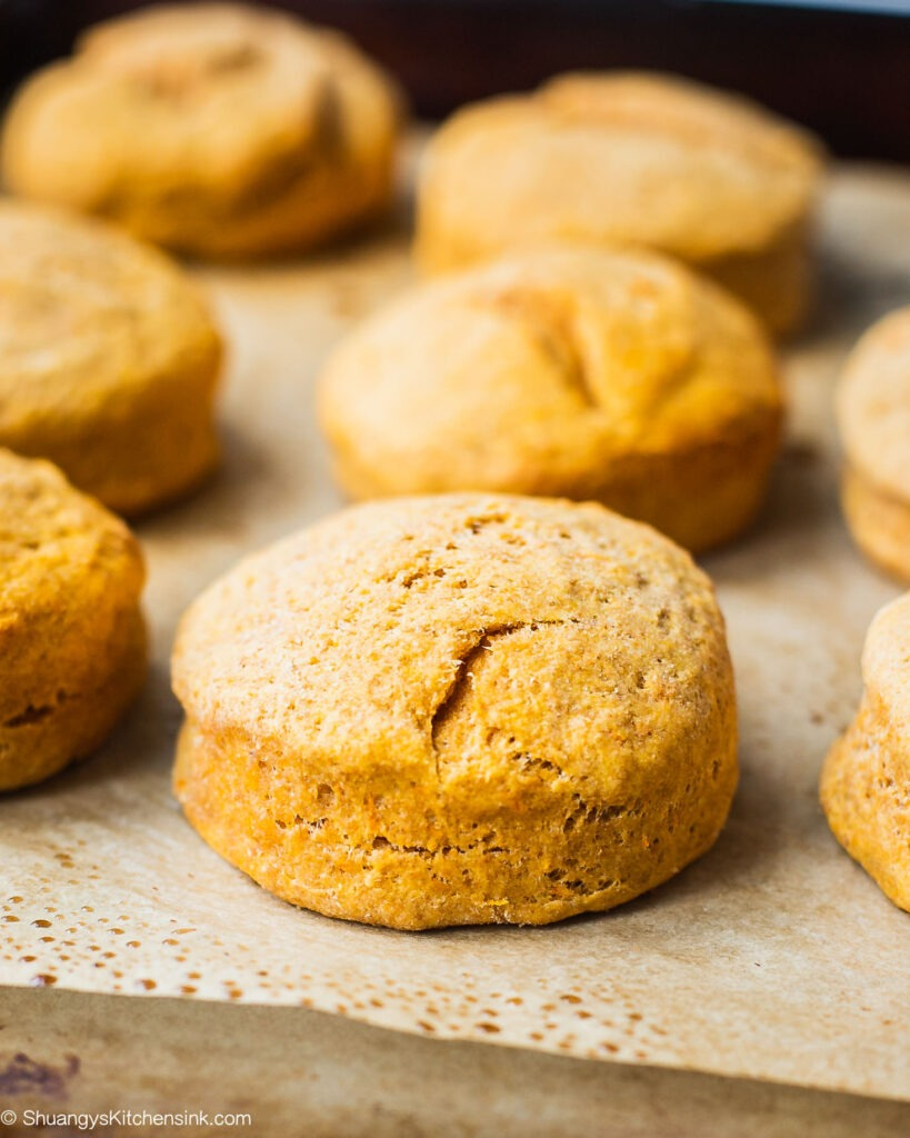 Sweet Potato Biscuits | Fluffy, soft, and buttery vegan biscuits made with whole wheat flour, sweet potato puree and dairy-free ingredients. You'll never believe how easy these sweet potato biscuits are to make! The perfect whole wheat breakfast biscuit or addition to any home-cooked meal. Serve these gluten free biscuits with plant based butter, nut butter or your favorite jam, for the whole family to enjoy. | #sweetpotatobiscuits #biscuitrecipe #glutenfreebiscuits #veganrecipe #veganbreakfast