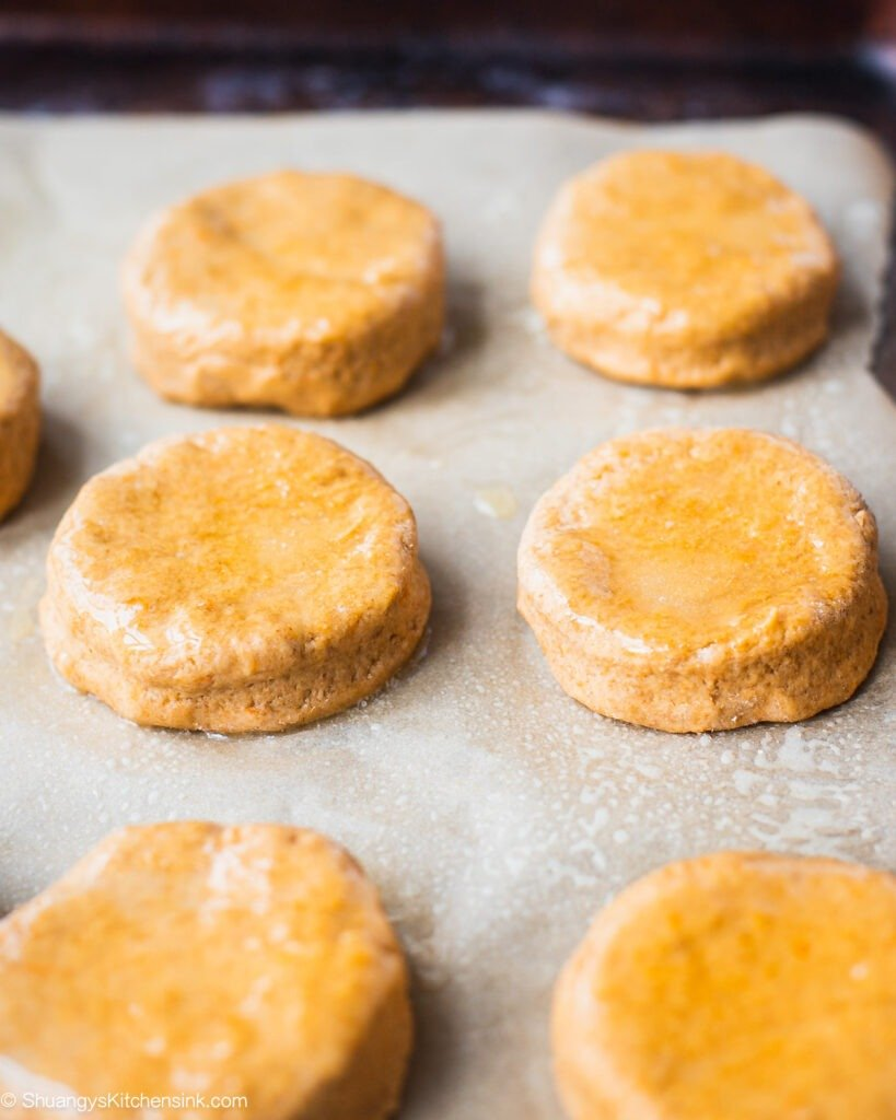 Instruction on how to make easy and healthy sweet potato biscuits. A batch of sweet potato biscuits ready to be baked.