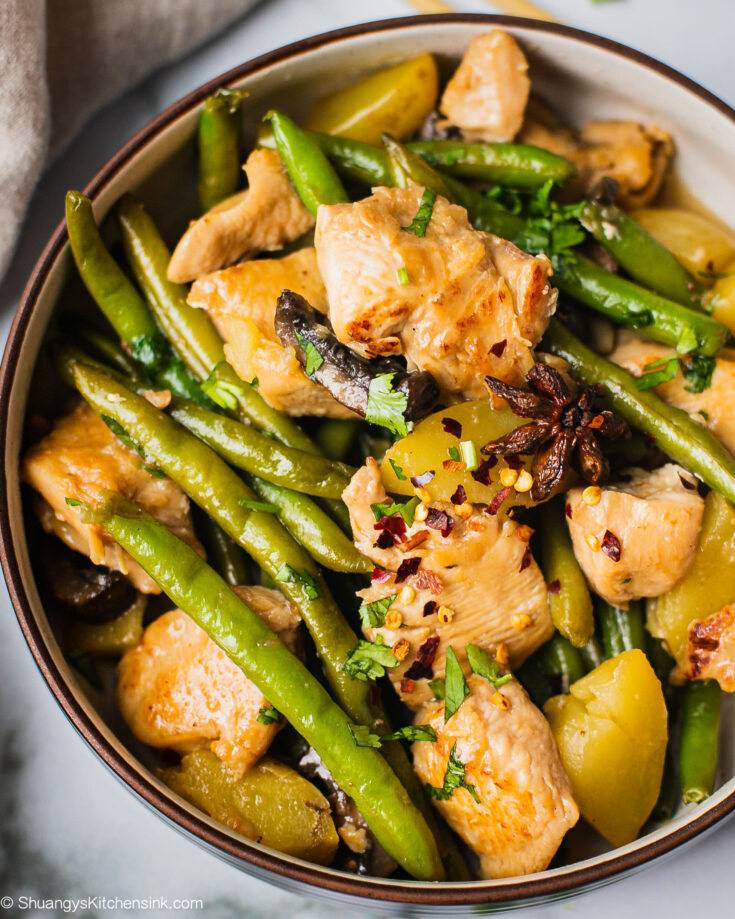 A pot of chicken green beans potatoes cooked to tender. It is Whole30, Paleo, gluten free and can be made keto as well.