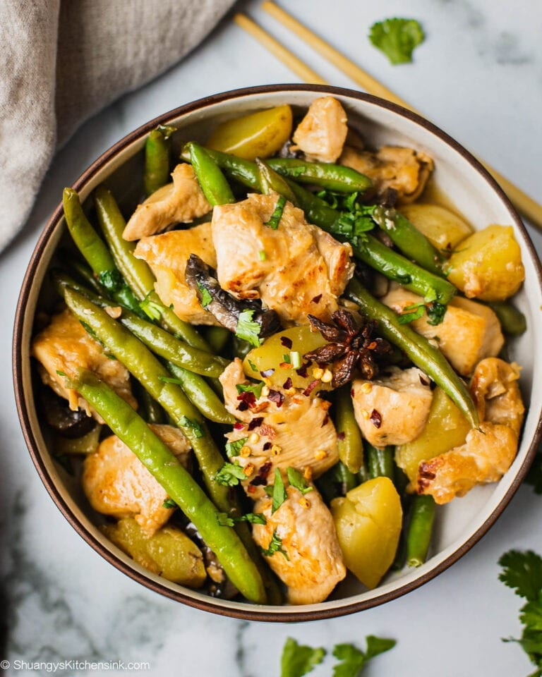 A bowl of Chicken Green beans potatoes that is my favorite homemade authentic and healthy Chinese food.