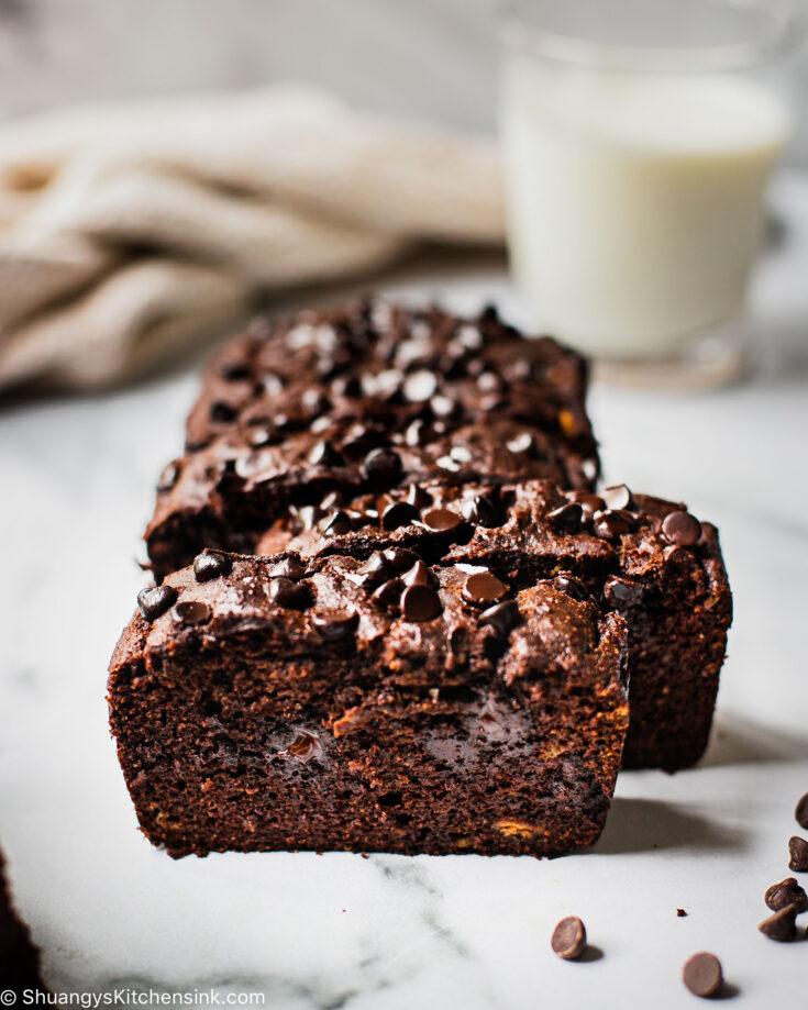 Five slices of gluten-free banana bread full of dark chocolate