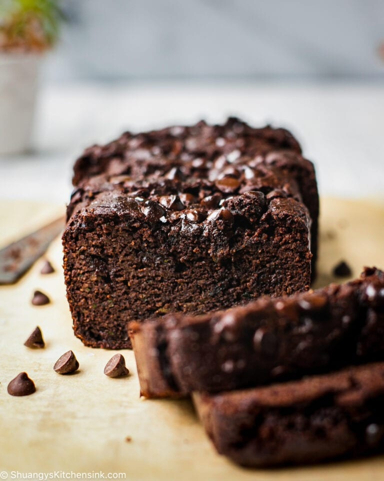 A few slices of Chocolate Zucchini Loaf that is soft and moist. This healthy Chocolate Zucchini Bread with chocolate chips are so delicious.