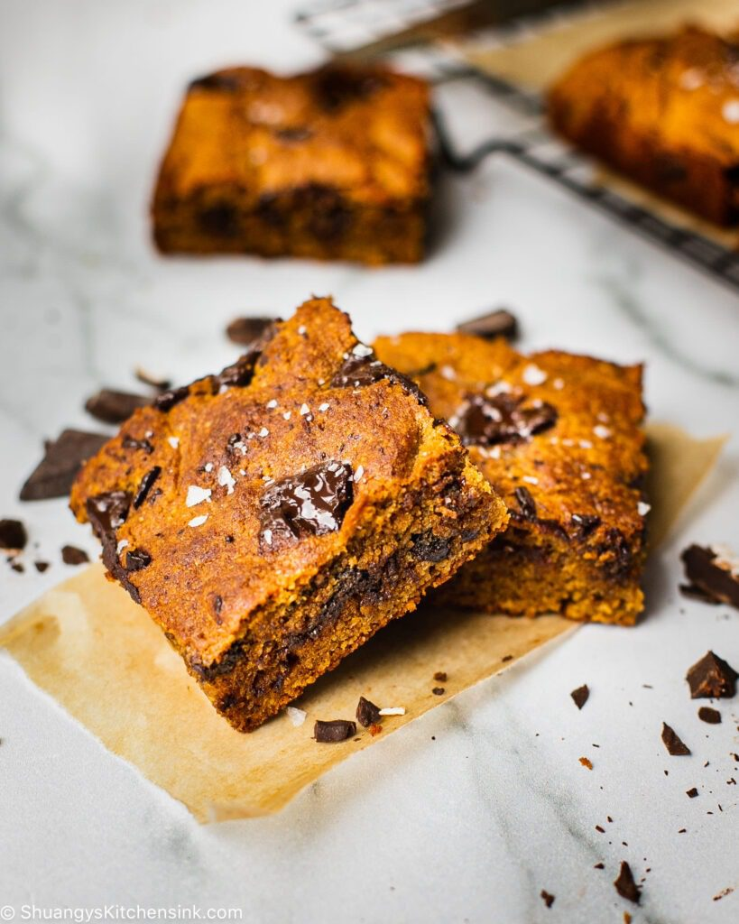 two golden brown pieces of healthy chocolate chip pumpkin bars baked with gluten free almond flour