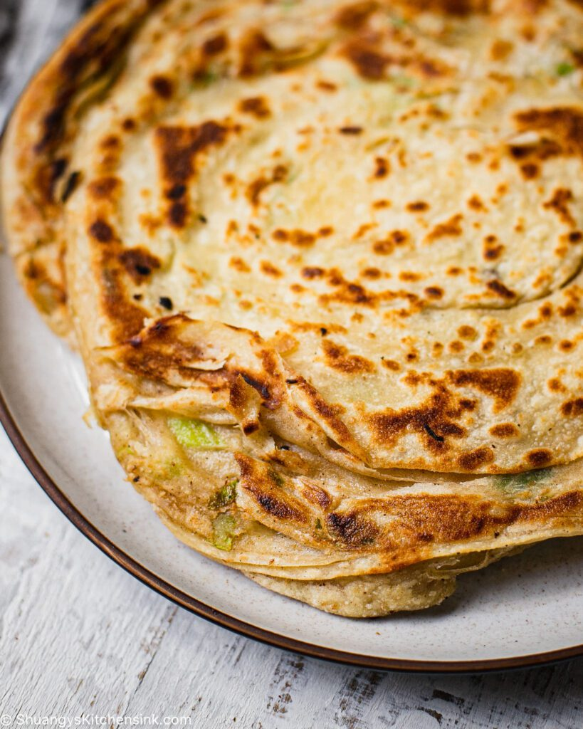 A freshly cooked golden brown scallion pancake