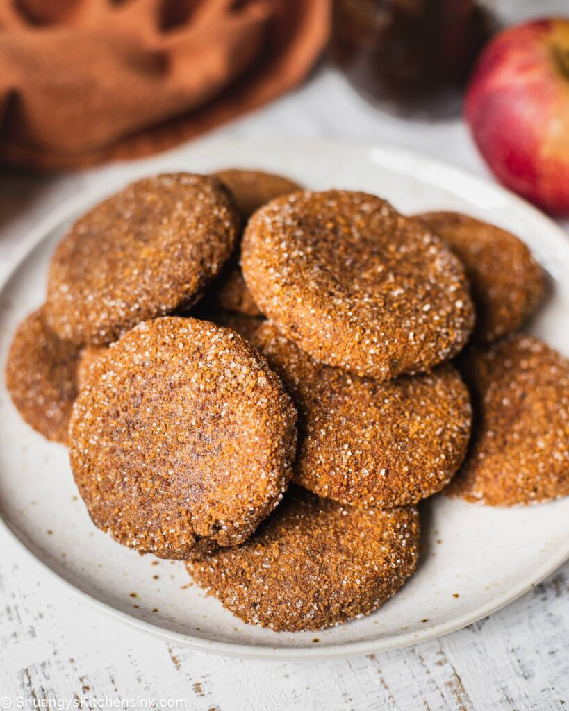 A plate full of apple butter cookies covered in coconut sugar and apple pie spice