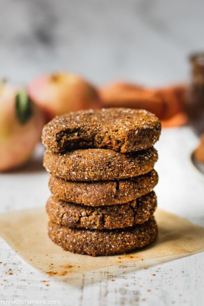 Soft and chewy apple butter cookies stacked on top of each other. There are five cookies and one has a bite taken from it