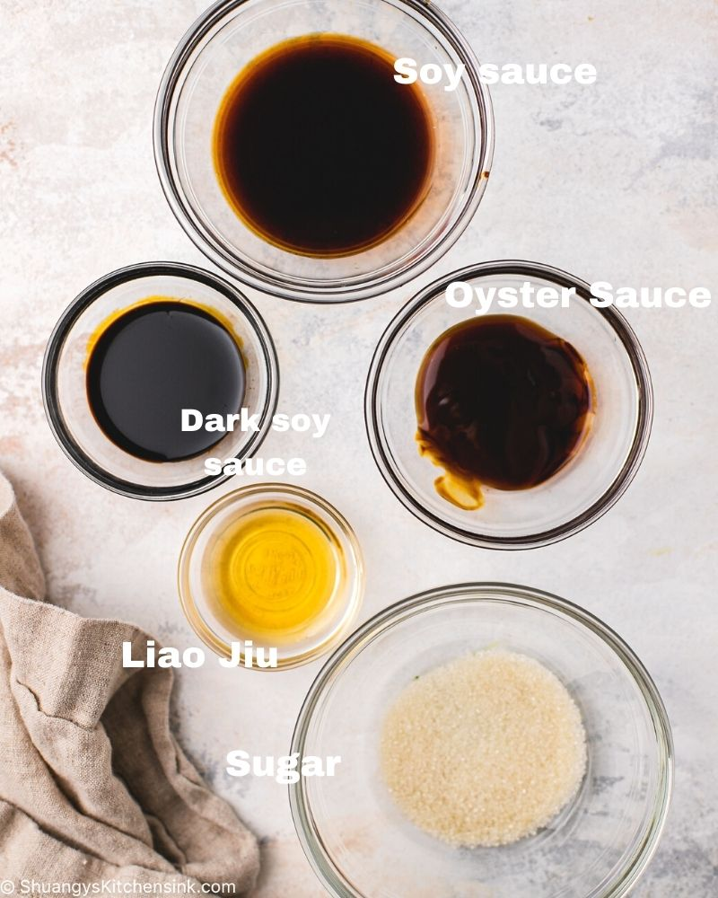glass bowls with soy sauce, oyster sauce, dark soy sauce, rice wine, and sugar