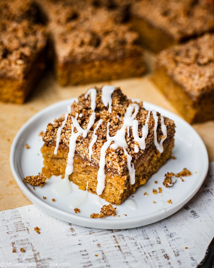 A moist gluten-free pumpkin coffee cake topped with a sweet paleo streusel and dairy-free icing
