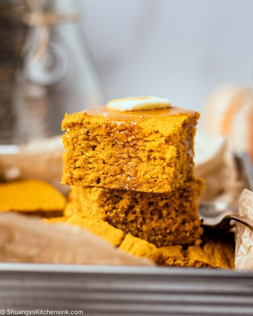 moist and fluffy gluten-free pumpkin cornbread topped with vegan butter