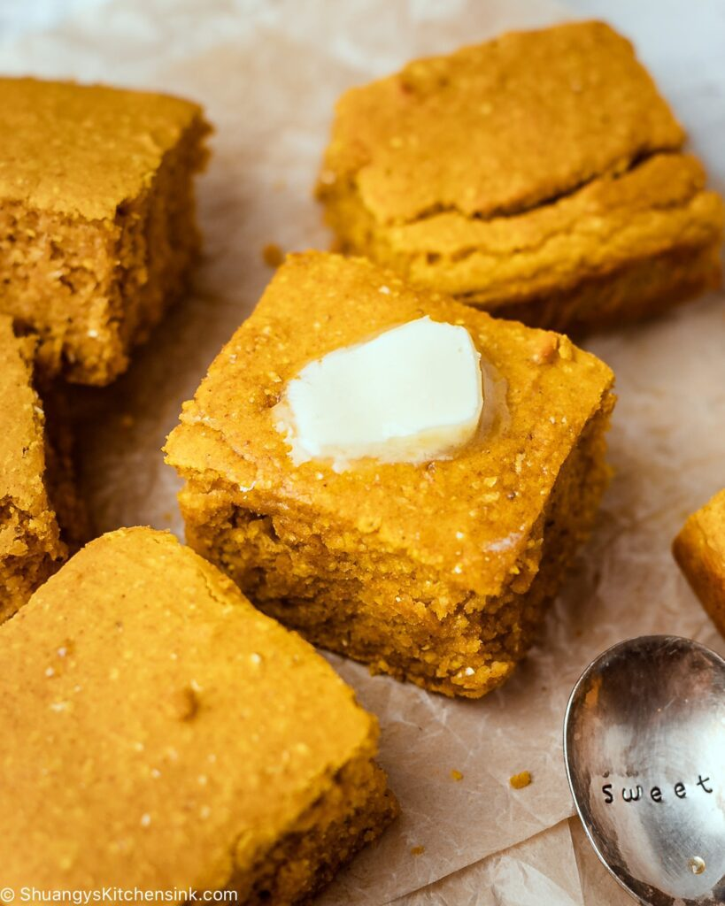 pieces of gluten-free maple pumpkin cornbread topped with melted dairy-free butter