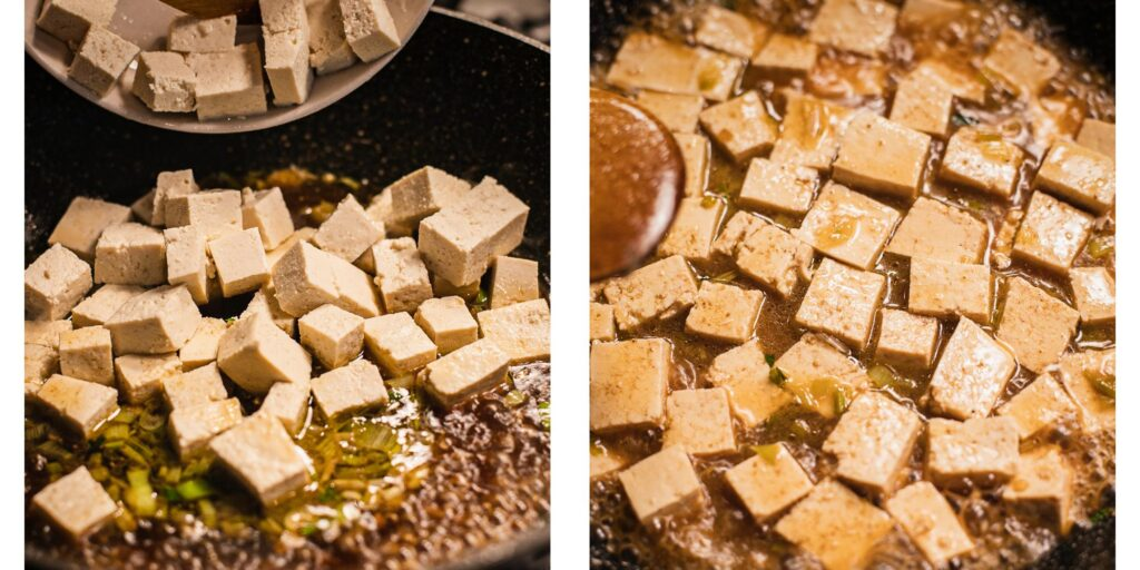 Cubed tofu is being cooked in a large wok