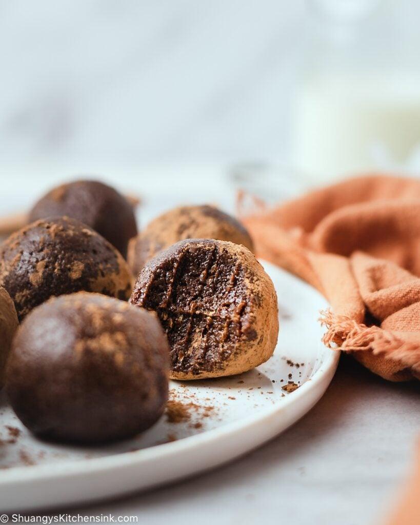 a plate with vegan dark chocolate energy balls