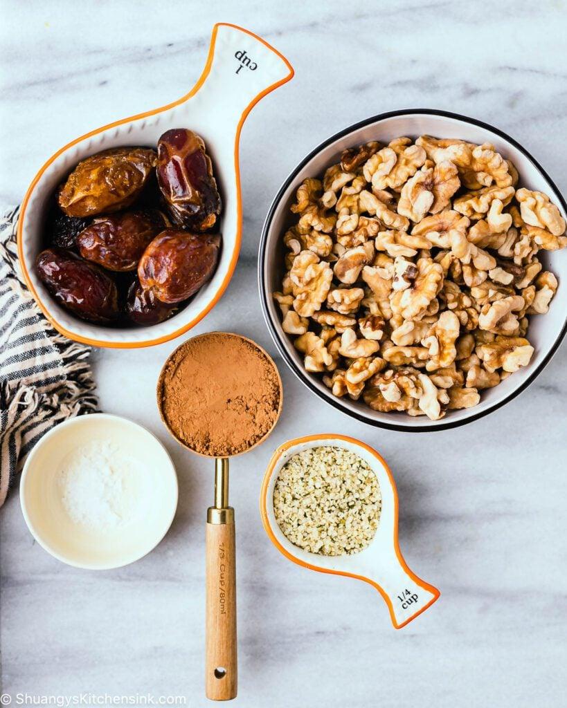 pretty bowls with dates, walnuts, cacao power, flakey sea salt, and hemp seeds